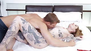 Tattooed MILF sucks and rides dick like in the movies