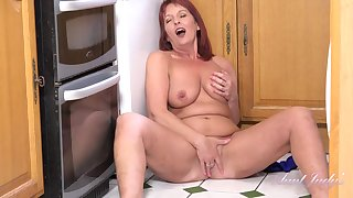 Red haired mommy took off her dress and started masturbating in the kitchen and enjoying it