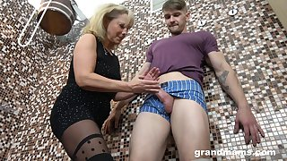 Aged unshaded gives a blowjob and tugjob to young guy in the sauna