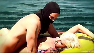 Hardcore having it away on the raft between a masked guy and a sexy blonde