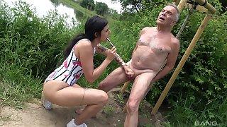 Provocative slut drops on her knees concerning suck an older man's dick
