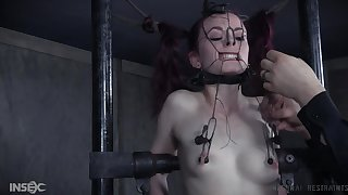 Redhead teen slave Ivy Addams in a painful agony session