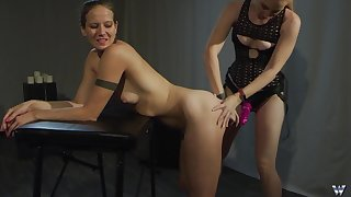 Submissive teen babe abused by a unspecified less a strap on adjacent to vassalage