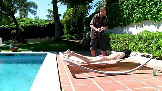 Sunbathing Amadea Emily masturbates and gets fucked hard by the pool